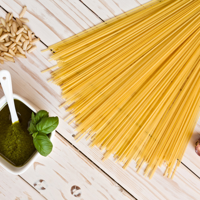 """""""Pesto genovese and linguine pasta, pine nuts and garlic on a table"""" stock image"""