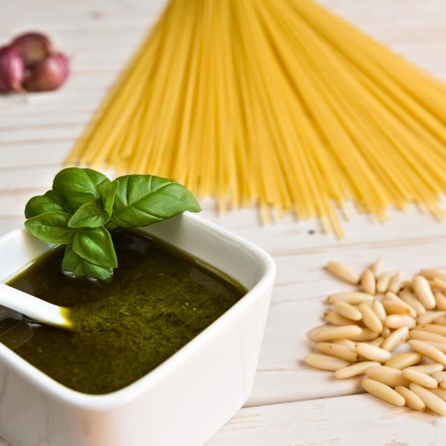 """Closeup of pesto genovese and linguine pasta, pine nuts and garlic"" stock image"