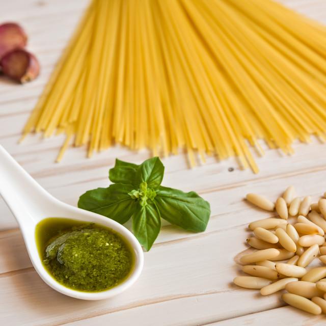 """Closeup of pesto genovese sauce and linguine pasta, pine nuts and garlic"" stock image"