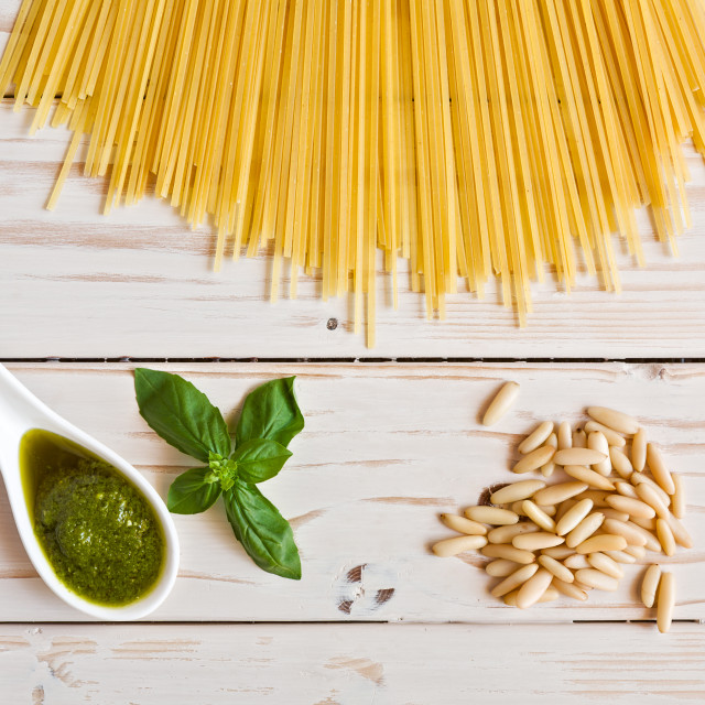 """""""Pesto genovese sauce and linguine pasta, pine nuts and garlic on a table"""" stock image"""