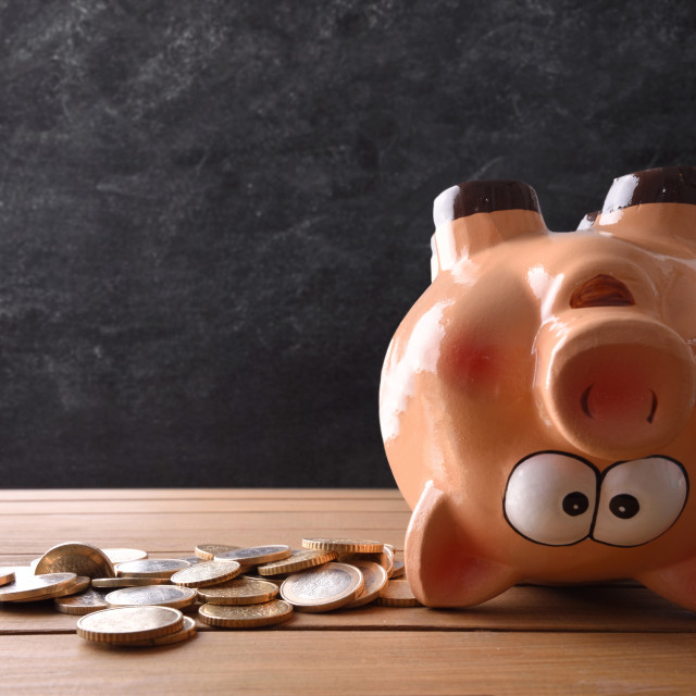 """""""Concept of spending the savings with piggy bank upside down"""" stock image"""