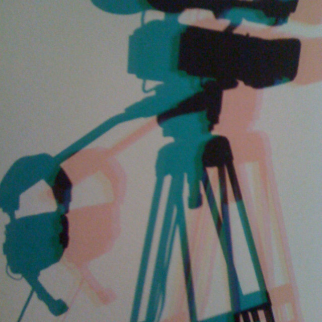 """""""Video camera and headphones on a tripod shadow"""" stock image"""