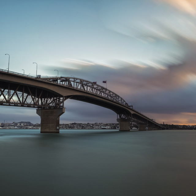 """Auckland Harbor Bridge at dusk"" stock image"