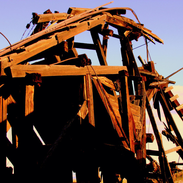 """A structure used to pull materials out of mine that is now falling apart in the abandoned mine town - desert of Arizona"" stock image"