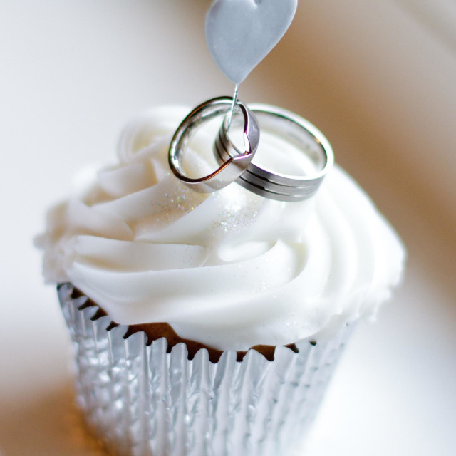 """Cupcake with a love heart and wedding rings"" stock image"