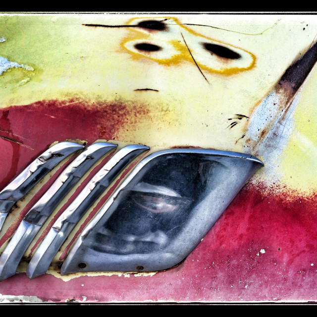 """""""Detail of trim on an old car in a junk yard"""" stock image"""