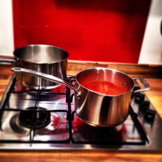 """Kitchen saucepan on hob cooking"" stock image"