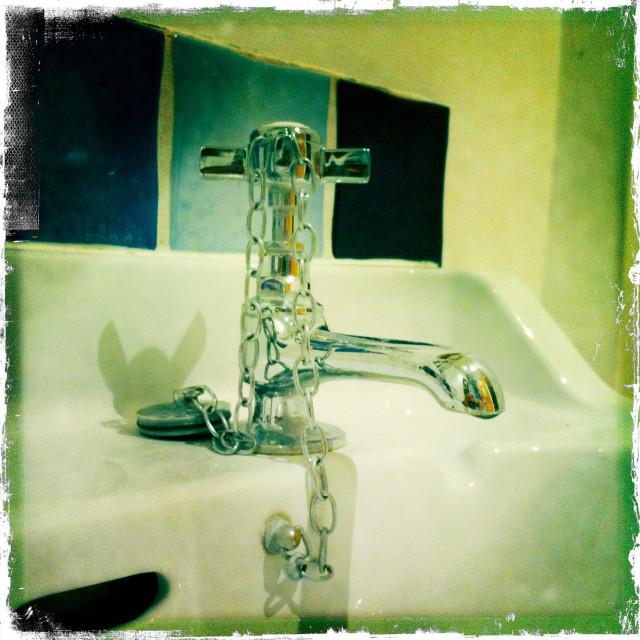 """Shiney bathroom tap and wash basin"" stock image"