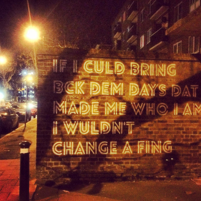 """Street art that says if I culd bring bck dem days dat made me who I am I wuldnt change a fing"" stock image"