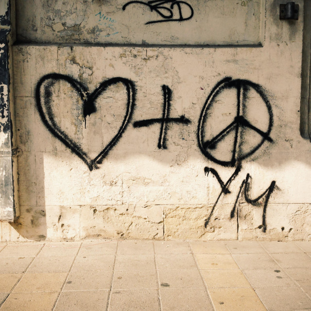 """""""Heart and peace symbols graffiti on a wall. Peace and love"""" stock image"""