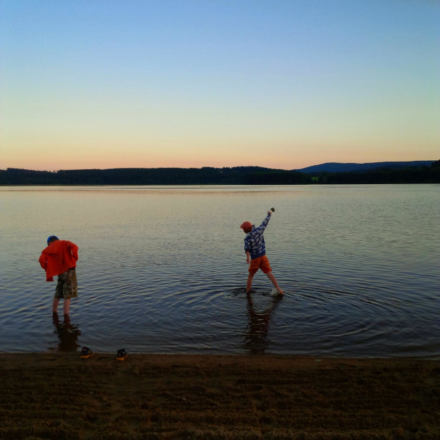 """""""Throwing rocks into a lake in rural Czech Republic. Credit photo by Paul Treacy."""" stock image"""