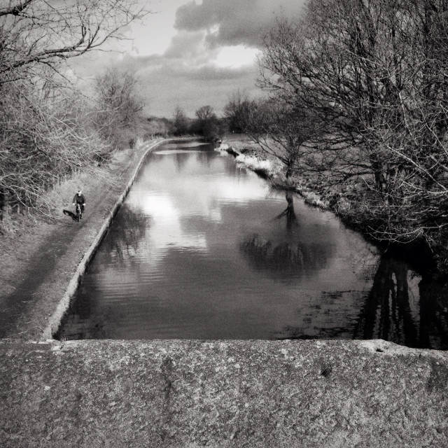 """Leeds Liverpool Canal. Cyclist on towpath"" stock image"