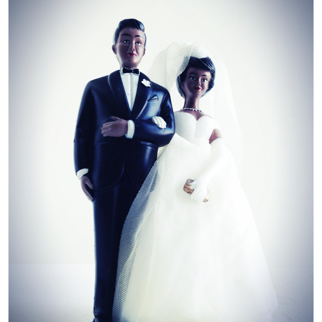 """""""A wedding cake topper of a black heterosexual couple."""" stock image"""