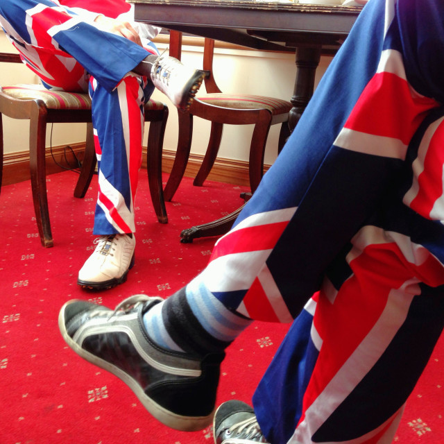 """""""Union flag trousers under table"""" stock image"""