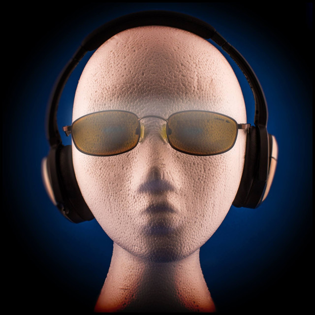 """Cool listener wearing sunglasses and headphones"" stock image"