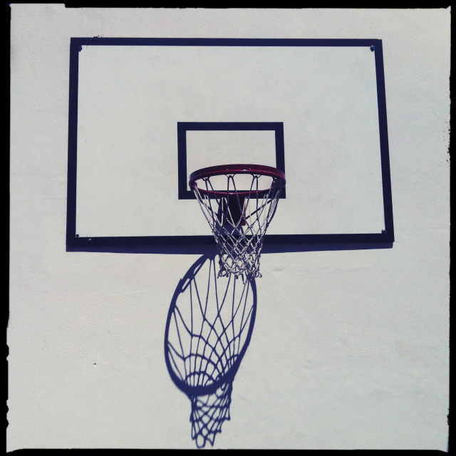"""""""Shadow of a basketball ring"""" stock image"""