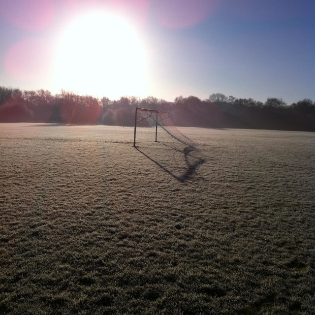 """""""Soccer match cancelled, frozen pitch."""" stock image"""