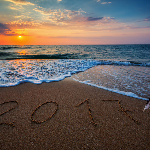 """Happy New Year 2017 concept, lettering on the beach"" stock image"