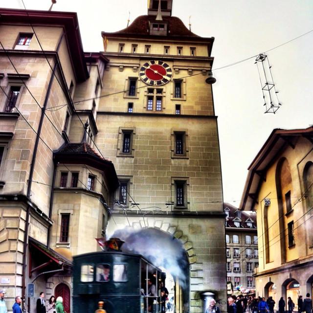 """Vintage steam tram puffs along Marktgasse, Berne, Switzerland"" stock image"
