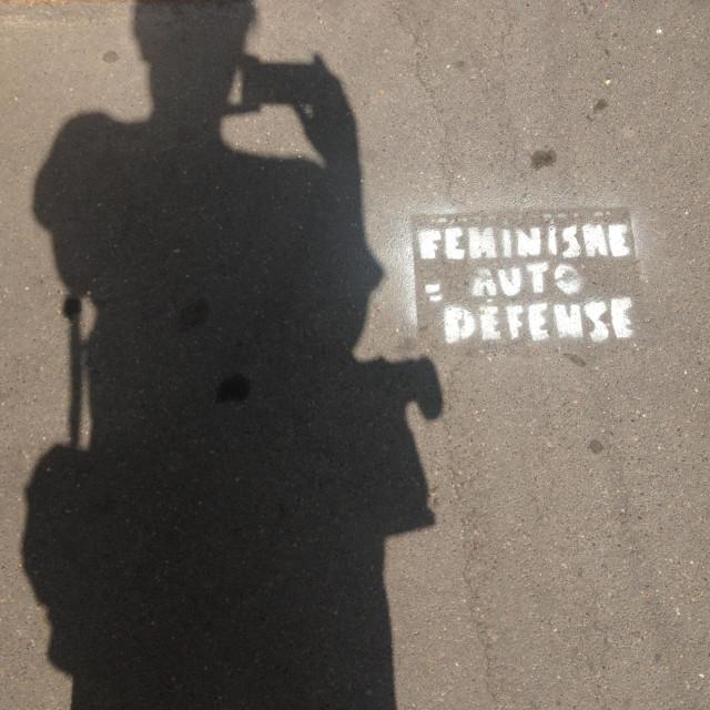 """Feminism = autodefense"" stock image"