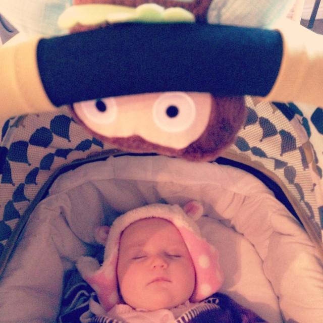 """Sleeping baby and baby toy"" stock image"
