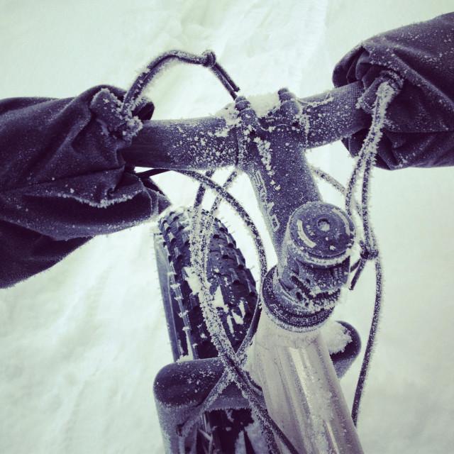 """Frosty bike ride. Snow and ice on a fat tire snow bike, Alaska."" stock image"