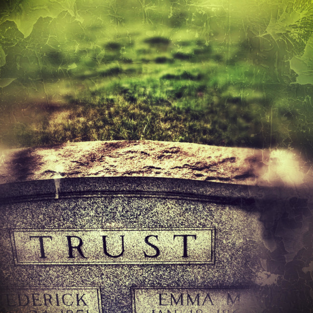 """""""The last name """"Trust"""" on a tombstone in a cemetery"""" stock image"""