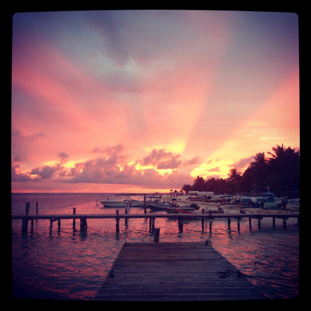 """""""Sunset over Isla Mujeres in Mexico"""" stock image"""