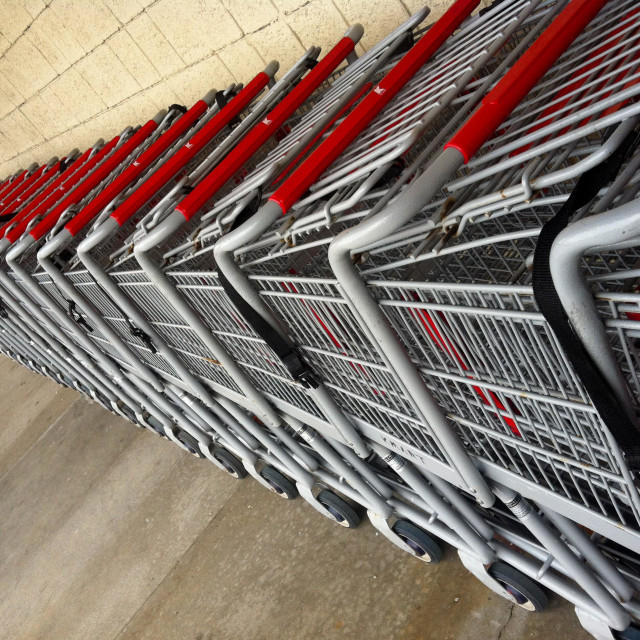 """A long line of shopping carts create an interesting perspective"" stock image"