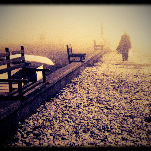 """Single figure walking on a foggy day"" stock image"