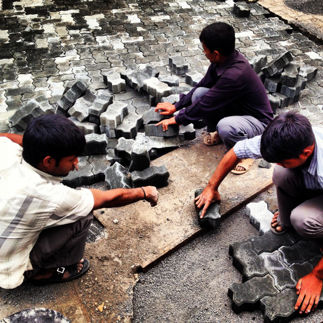 """The road makers of Mumbai, paver block, getting worst day by day."" stock image"