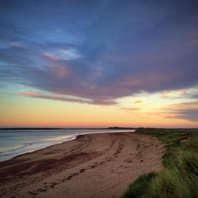 """Sunrise over sand dunes on the Norfolk coastline"" stock image"