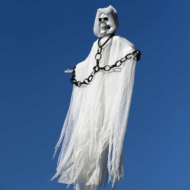 """Skeleton spirit figure floating in the sky."" stock image"