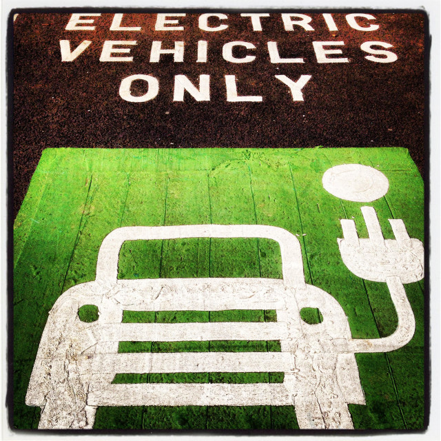 """""""Parking space and recharging point for electric vehicles."""" stock image"""