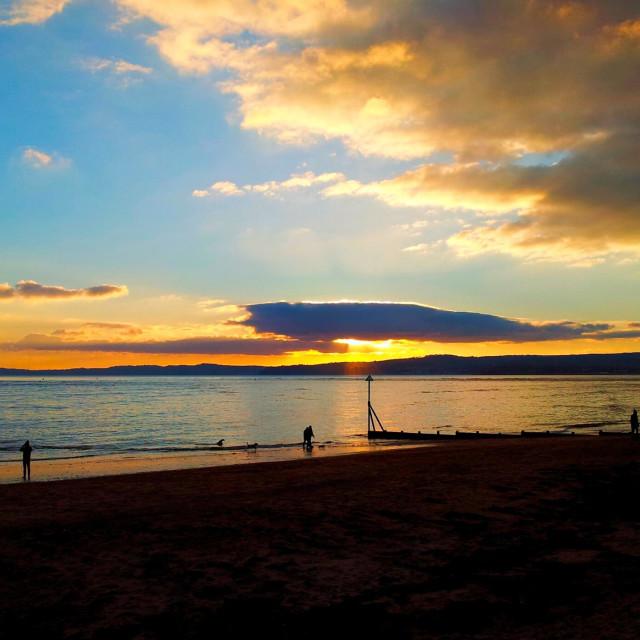 """Sunset over Exmouth beach,Devon, uk"" stock image"