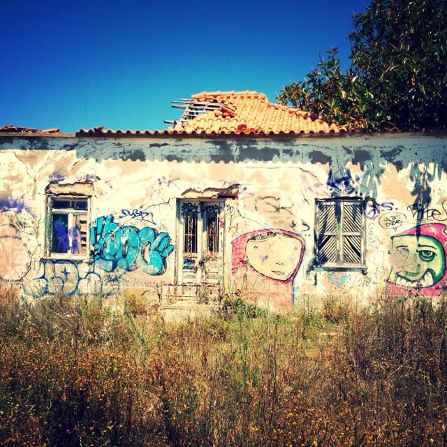 """Abandoned graffitied house"" stock image"