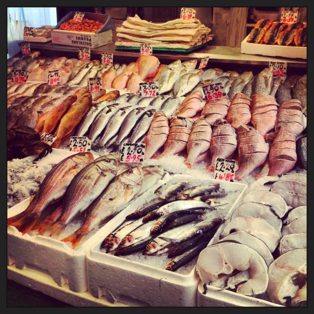 """Fishmonger market stall in Brixton Village London."" stock image"