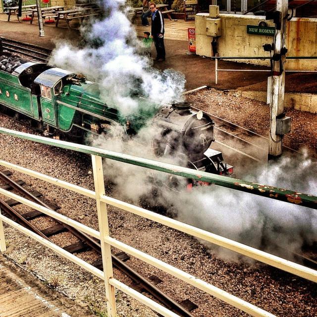 """Steam Train leaving station"" stock image"