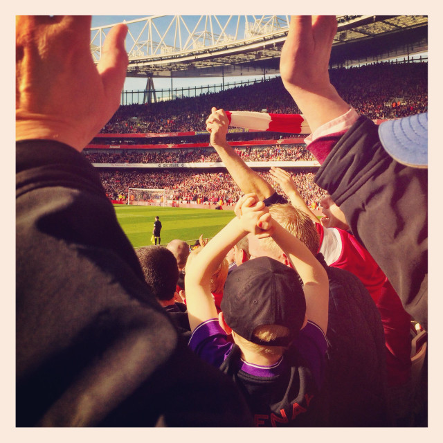 """Fans cheering at Emirates"" stock image"