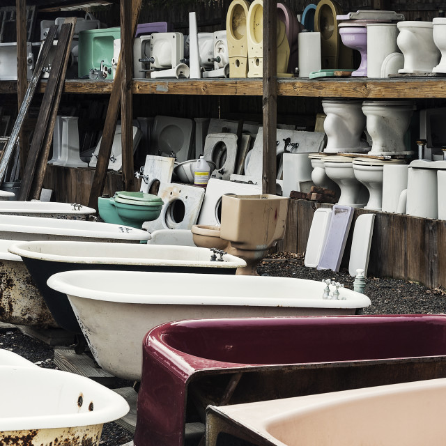"""Reclaimed toilets and bath tubs at a salvage yard."" stock image"