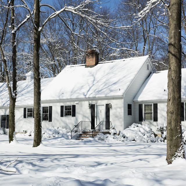 """Snow falls outside a rural house, New Jersey, USA"" stock image"