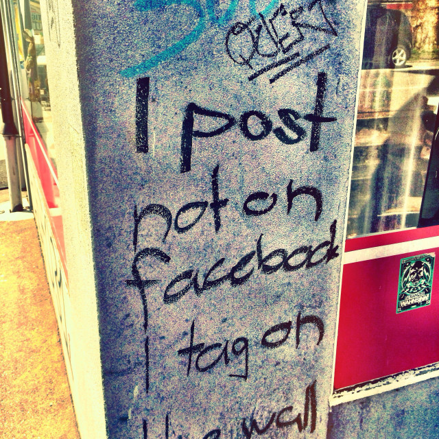 """""""Graffiti - I don't post on Facebook, I tag on the wall. Welcome to the mean streets of Berne, Switzerland."""" stock image"""