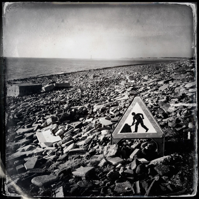 """Man at work sign on Crosby beach, Merseyside"" stock image"