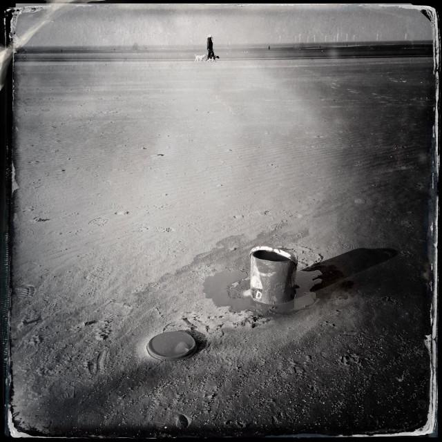 """Tin of paint on Crosby beach"" stock image"