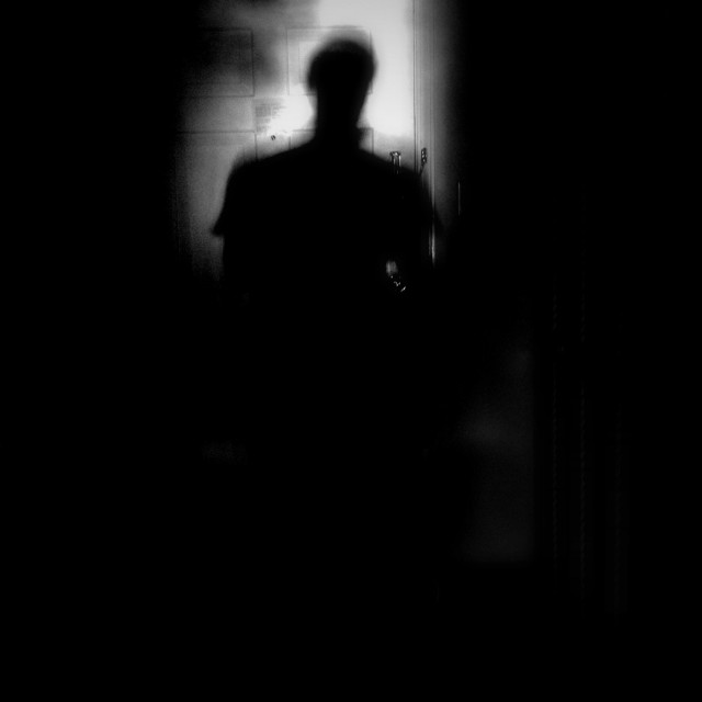 """Shadow of man on door"" stock image"