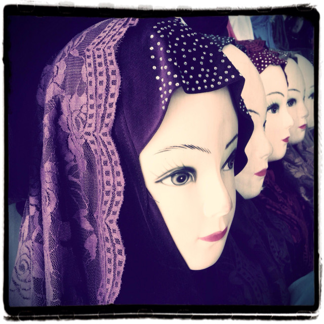 """Mannequins displaying traditional headscarf in the old city Jerusalem Israel"" stock image"