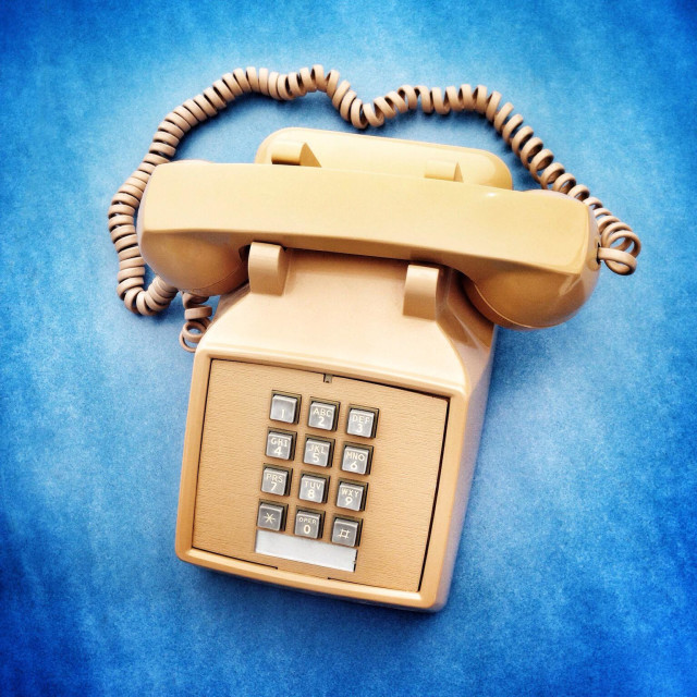 """Punch button retro land line phone."" stock image"
