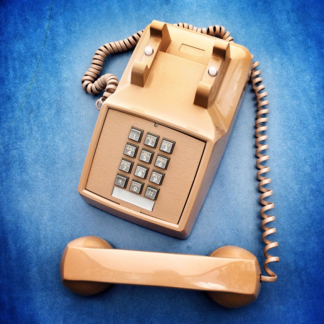 """Retro office phone with handset off. Punch button dialing."" stock image"