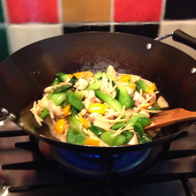 """Stir fry in wok on stove"" stock image"