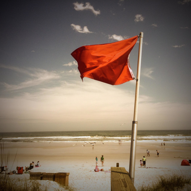 """Red warning flag at Jacksonville Beach, Florida"" stock image"